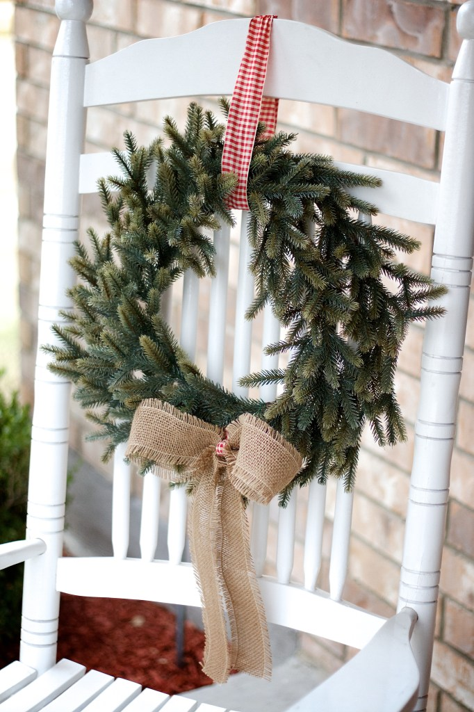 rocking chair with a wreath attached