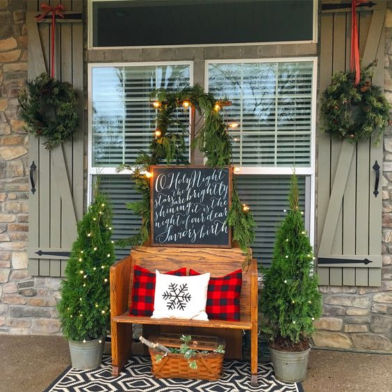 wooden pew festive front porch holiday setup