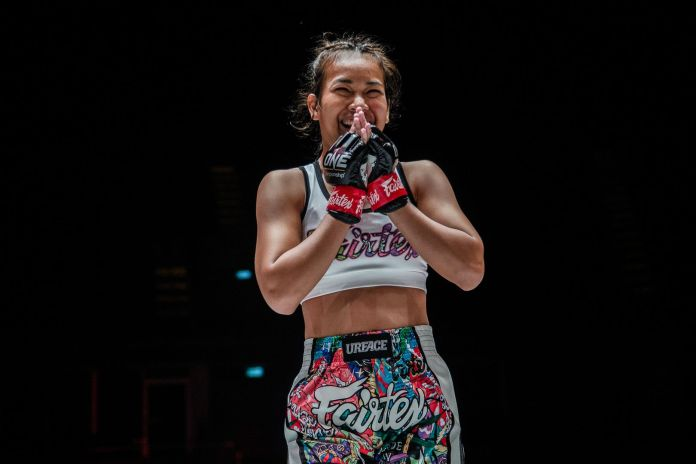 Muay Thai fighter Wondergirl Fairtex holds her hands together following her debut victory
