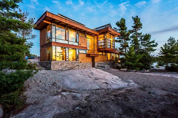 Post and beam cottage on a rocky outcropping off Georgian Bay