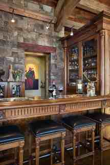 Rustic Home Bar with Stone and Wood