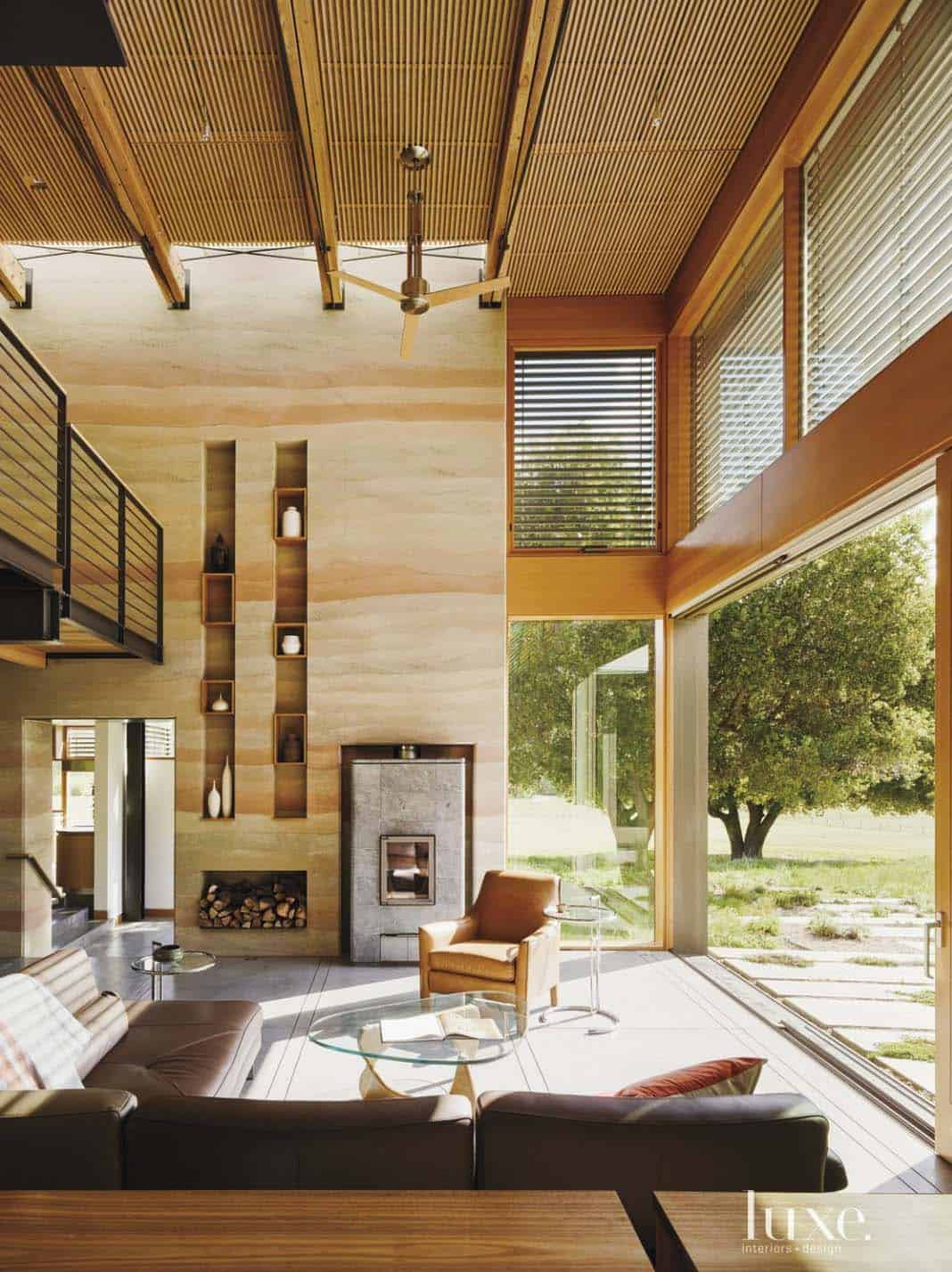 Rammed earth house hidden in the forested hills of Northern California