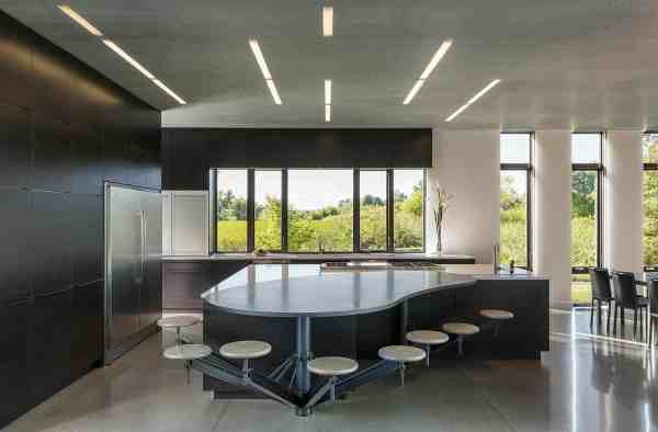 Industrial Modern House Boasts Serene Lakeside Setting