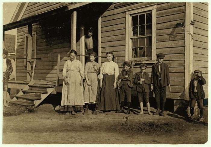 5. According to the photographer, everyone in this family photo works at the mill.
