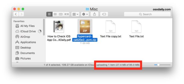 The status bar shows details of iCloud Drive uploads
