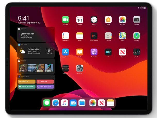 iPadOS dark home screen with widgets