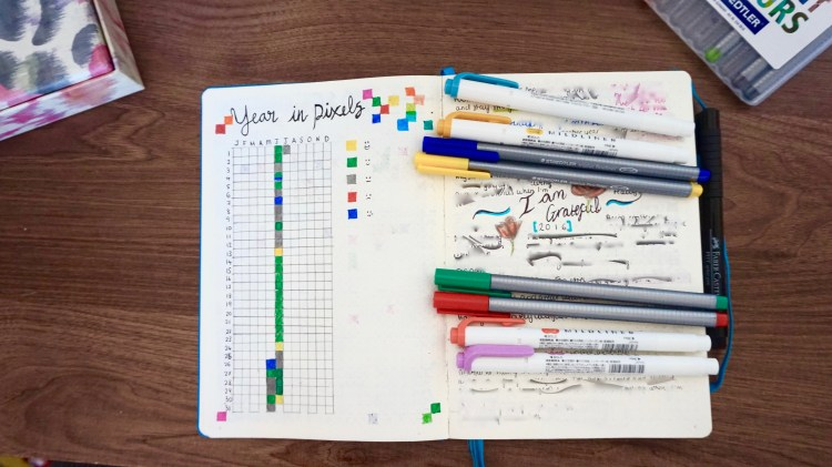 """My """"Year In Pixels"""" log and Gratefulness log (that I recently filled up and had to start a new one!) It's blurred because most of it is quite personal."""