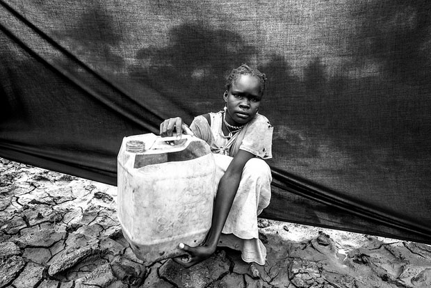 The most important thing Maria brought with her is the jerrycan (water container) that she holds in this photograph taken at Jamam camp in Maban County, South Sudan.