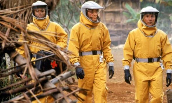"""Cuba Gooding, Jr., (left), Kevin Spacey and Dustin Hoffman (right) in the 1995 film """"Outbreak."""" (Promo photo/Warner Bros.)"""