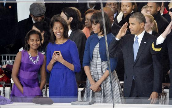 Sasha Obama, Malia Obama, First Lady Michelle Obama and U.S. President Barack Obama arrive at the reviewing stand at the Inaugural Parade after his public inauguration ceremony in Washington, D.C. on January 21, 2013. President Obama was sworn-in for a second term as the 44th President of the United States. UPI/Brian Kersey