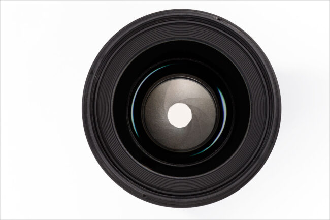 An image of a lens and its aperture blades explaining aperture photography definition