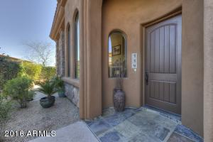 Private entry with wrap around patio