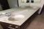 Dual sinks in hall bath cultured marble