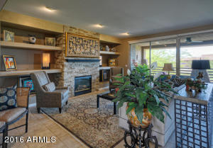 WONDERFUL STONE-FACED GAS FIREPLACE, DECORATOR NICHES, TRAVERTINE TILE FLOORS & GORGEOUS VIEWS!
