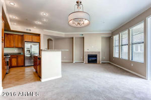 Light and bright great room with gas fireplace. Open kitchen makes this condo a special place to entertain! This one bedroom is fantastic!