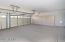 2.5 car garage with storage cabinets
