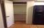 Pantry in kitchen & coat closet which is located off garage which door is to left but not seen in this picture.