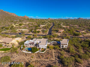 TO THIS SPRAWLING PRIVATE COMPOUND ON 4.27 ACRES WITH ENDLESS VIEWS