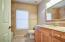 2nd full bath is granite with travertine surround