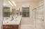 Raised Beech cabinets with Granitex countertop, dual sinks, large shower; there is also a private toilet room