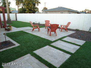 Newly Graded yard with artificial grass and Travertine pavers