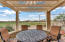 Dining area on patio with extra bench seating