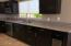 A well laid out kitchen with new Shaker Style expresso cabinets topped with granite