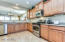 Open concept Kitchen with beautiful Staggered Maple Toffee Cabinetry w/ pull out shelves, Stainless Steel Appliances, Undercabinet Lighting, Abundant Counter Space, Breakfast Bar, and Pantry.