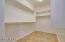 16 x 16 ceramic tile throughout large master closet!
