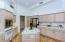 Kitchen with view towards hallway