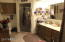 Double sinks, walk-in shower with seat, neutral tile - master one