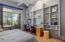 Master bedroom with hardwood flooring.