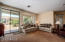 Spacious great room, with view window to greenbelt area.