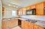 Kitchen features built in microwave, cooktop, dishwasher, disposal and refrigerator.
