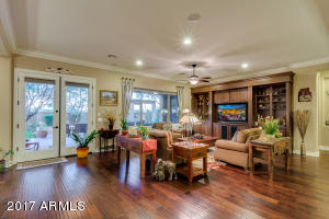 Beautiful Wood Floors and Built in Wall Unit