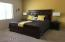 A very large master bedroom can handle the biggest of pieces
