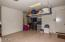 2 ft garage extension & Custom Cabinets and Overhead Storage. With Walk-Out door to side of house