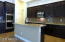 Gourmet Kitchen with double oven, microwave and gas cooktop