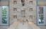 Exquisite master bath with romantic flickering limestone candle wall