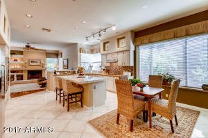 Open and spacious breakfast nook, kitchen, and family room