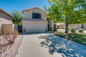 front yard with beautiful shade tree 2 car garage and plenty of parking