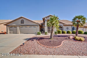 Meticulously landscaped yard with stately curb appeal
