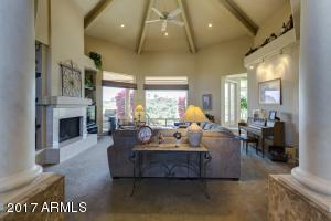 A huge great room with unique 22 ft. vaulted, beamed ceilings and expansive windows provide the WOW factor.