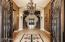 Double iron doors lead to a grand foyer. You've arrived!