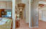 Enter to an open floor plan with arched solid wood doors and doorways through-out home. Beautiful hardwood floors in main living areas