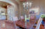 Dining Room opens to custom kitchen. Complete with hard wood floors and wood beams.