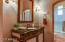 Bathroom with custom cabinetry and private tub/shower.