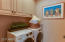 Laundry room with custom cabinetry .