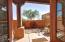 French doors off office/ 4th bedroom into front patio and courtyard.