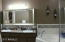 Beautiful Custom Mirror and Dual Sinks in Master